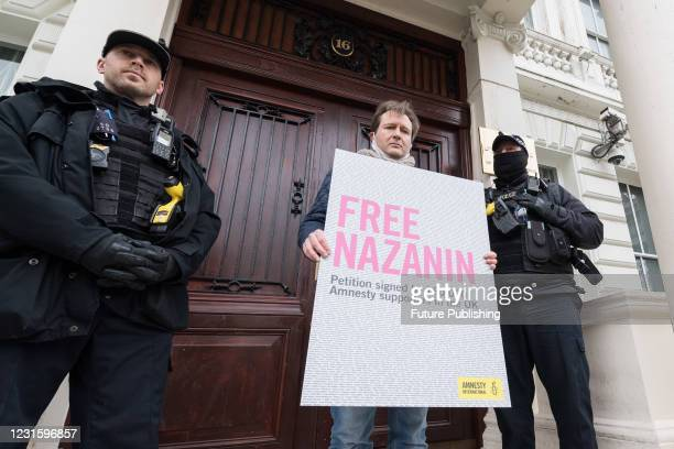 Richard Ratcliffe attempts to deliver a 160,000-signature Amnesty International petition to the Embassy of Iran in London during a protest for an...