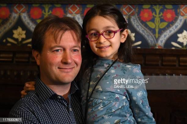 Richard Ratcliffe, husband of British-Iranian aid worker Nazanin Zaghari-Ratcliffe jailed in Tehran since 2016, holds his daughter Gabriella during a...