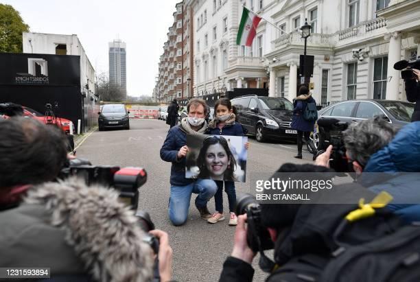 Richard Ratcliffe, husband of British-Iranian aid worker Nazanin Zaghari-Ratcliffe jailed in Tehran since 2016, and his daughter Gabriella, hold a...