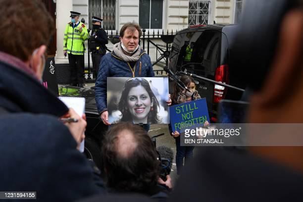 Richard Ratcliffe, husband of British-Iranian aid worker Nazanin Zaghari-Ratcliffe jailed in Tehran since 2016, and his daughter Gabriella, attend a...