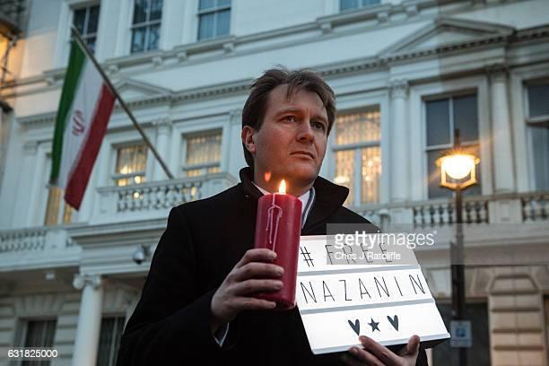 Richard Ratcliffe, husband of Nazanin Zaghari-Ratcliffe holds a '#Free Nazanin' sign and candle during a vigil for British-Iranian mother, Nazanin...