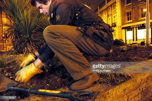 Richard Reynolds, founder of The Guerrilla Gardening organisation in action, Southwark, London. 04.04.06 .