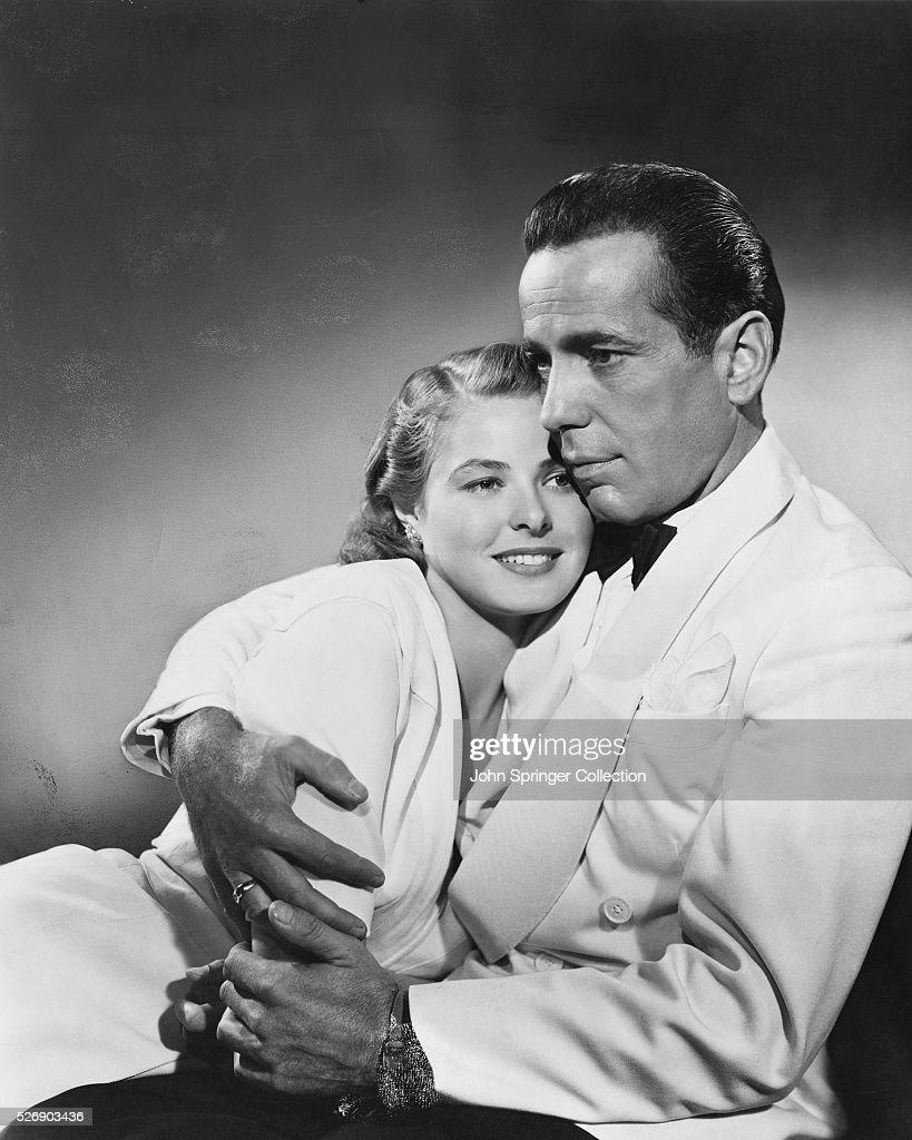 Richard 'Rick' Blaine (Humphrey Bogart) holds a smiling Ilsa Lund Laszlo (Ingrid Bergman) in the classic love story Casablanca.