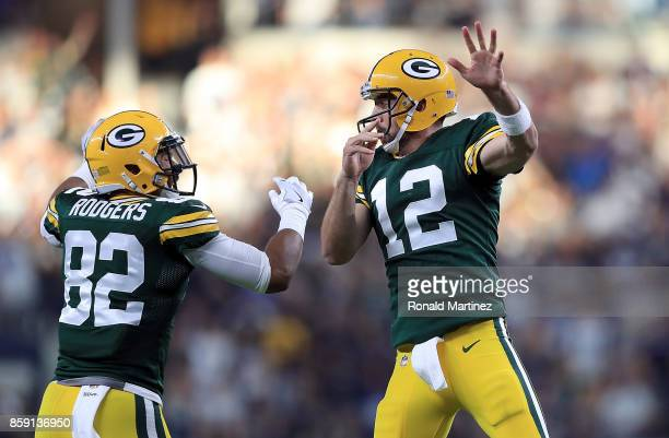 Richard Rodgers and Aaron Rodgers of the Green Bay Packers celebrate the game winning touchdown against the Dallas Cowboys in the fourth quarter at...