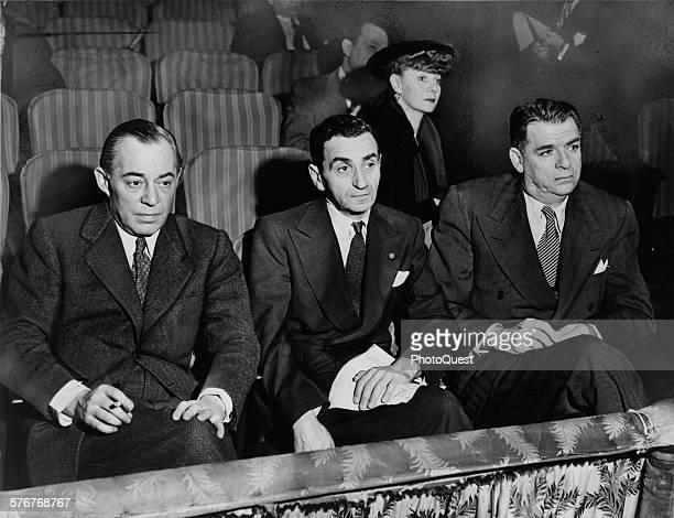 Richard Rodgers Irving Berlin Oscar Hammerstein II and seated in back Helen Tamiris watching auditions on stage of the St James Theatre New York New...