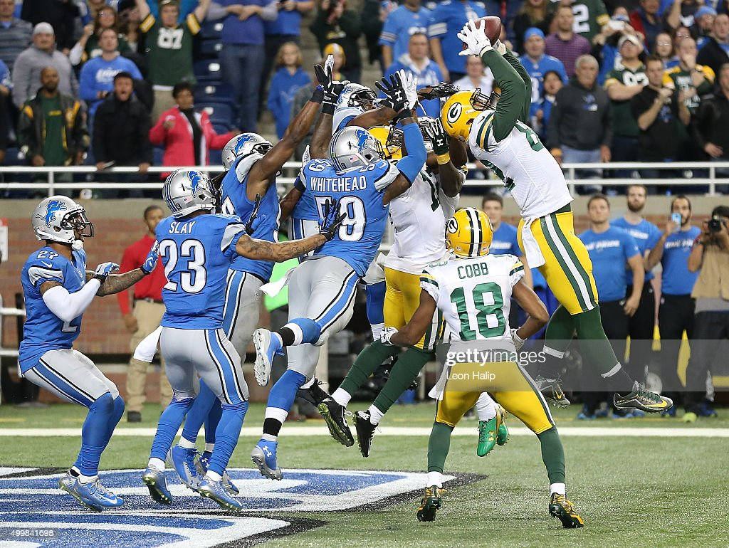 Richard Rodgers #82 of the Green Bay Packers catches a fourth quarter touchdown to win the game 27-23 over the Detroit Lions on December 3 2015 at Ford Field in Detroit, Michigan.