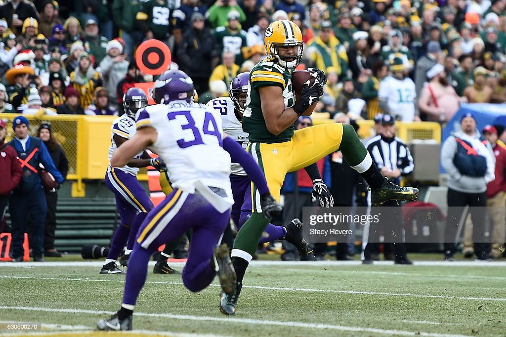 Richard Rodgers #82 of the Green Bay Packers catches a pass for a touchdown during the second half of a game against the Minnesota Vikings at Lambeau Field on December 24, 2016 in Green Bay, Wisconsin.