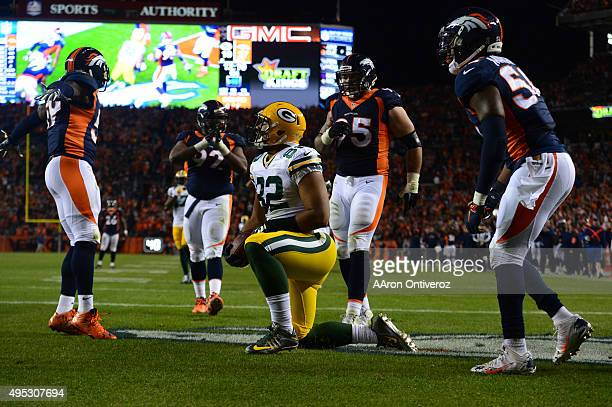 Richard Rodgers of the Green Bay Packers recovers a fumble giving the Broncos a safety The Denver Broncos played the Green Bay Packers at Sports...