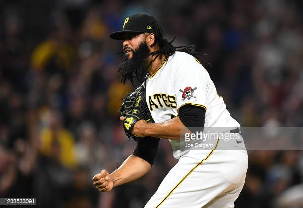 Richard Rodriguez of the Pittsburgh Pirates celebrates after a 11-10 win over the Cleveland Indians at PNC Park on June 18, 2021 in Pittsburgh,...
