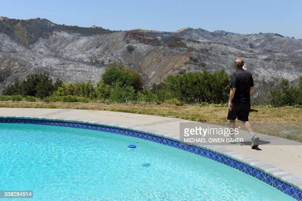 Richard Rosenberg looks at the burnt hills his home June 5 2016 in Calabasas California Some 5000 people were evacuated from the brushfire which...