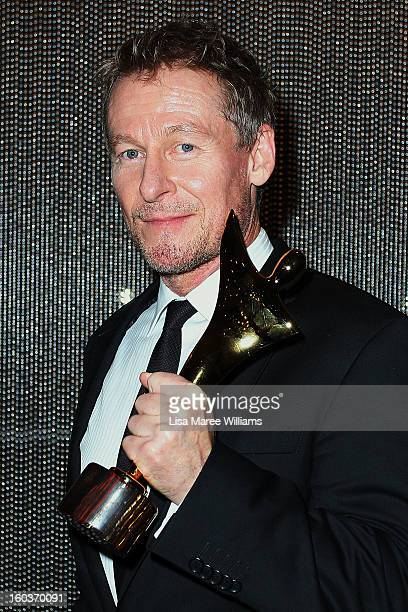 Richard Roxburgh celebrates his award for Best Lead Actor in a Television Drama for 'Rake' at the 2nd Annual AACTA Awards at The Star on January 30...