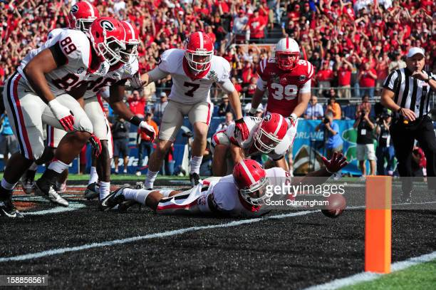 Richard Samuel IV of the Georgia Bulldogs is unable to recover a blocked punt in the end zone against the Nebraska Cornhuskers during the Capital One...