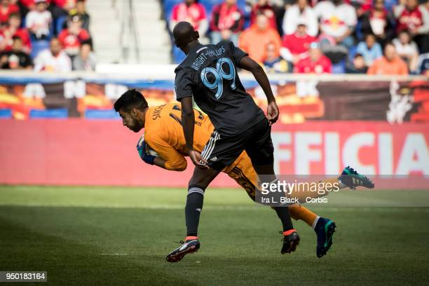 Richard Sanchez of Chicago Fire blocks the shot on goal by Bradley WrightPhillips of New York Red Bulls during the Major League Soccer match between...