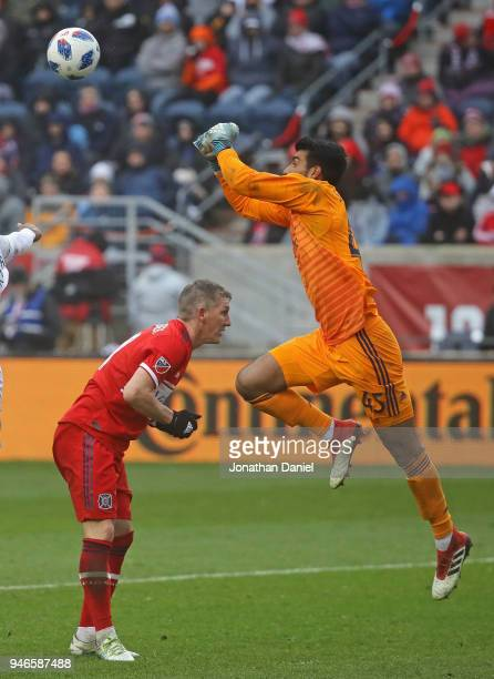 Richard Sanchez of the Chicago Fire leaps over teammate Bastian Schweinsteiger to make a save against the Los Angeles Galaxy at Toyota Park on April...