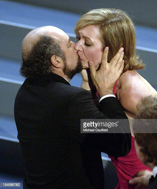 Richard Schiff kisses Allison Janney for her win for Best Actress in a Drama Series 'The West Wing' at the 54th Annual Emmy Awards
