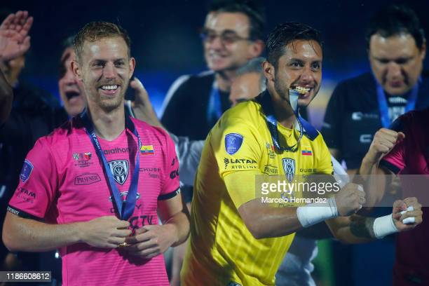 Richard Schunke and Hamilton Piedra celebrate with their medals after winning the final of Copa CONMEBOL Sudamericana 2019 between Colon and...