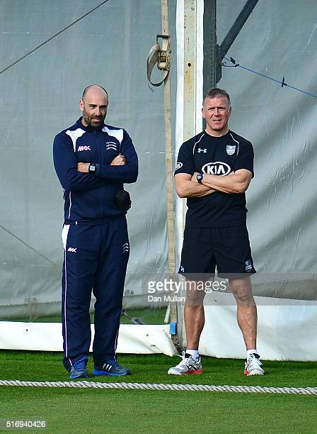 Richard Scott Head Coach of Middlesex watches the game alongside Alec Stewart Surrey's Director of Cricket during day one of the preseason friendly...