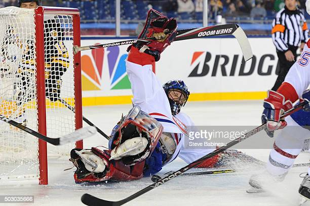 Richard Sevigny of the Montreal Canadiens dives to make a save against the Boston Bruins during the alumni game December 31 2015 during 2016...