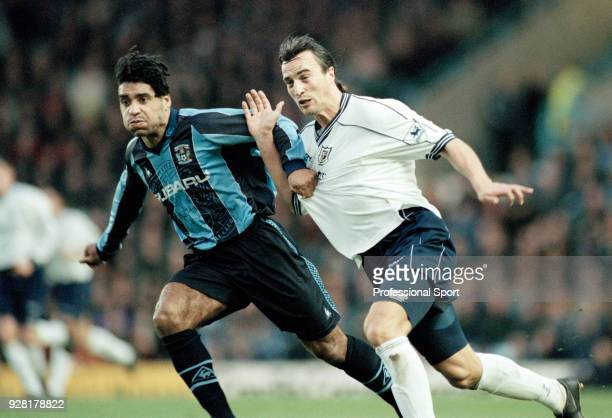 Richard Shaw of Coventry City tussles with David Ginola of Tottenham Hotspur during an FA Carling Premiership match at Highfield Road on December 13...