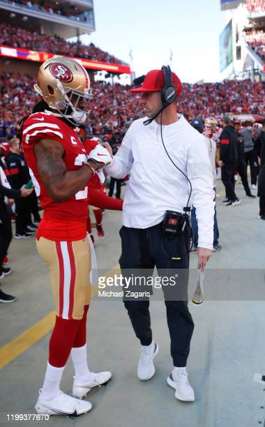 Richard Sherman and Head Coach Kyle Shanahan of the San Francisco 49ers shake hands on the sideline prior to the game against the Minnesota Vikings...