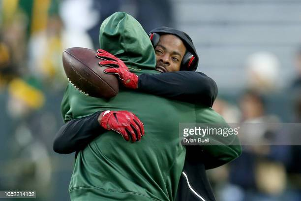 Richard Sherman of the San Francisco 49ers and Jimmy Graham of the Green Bay Packers meet before the game at Lambeau Field on October 15 2018 in...