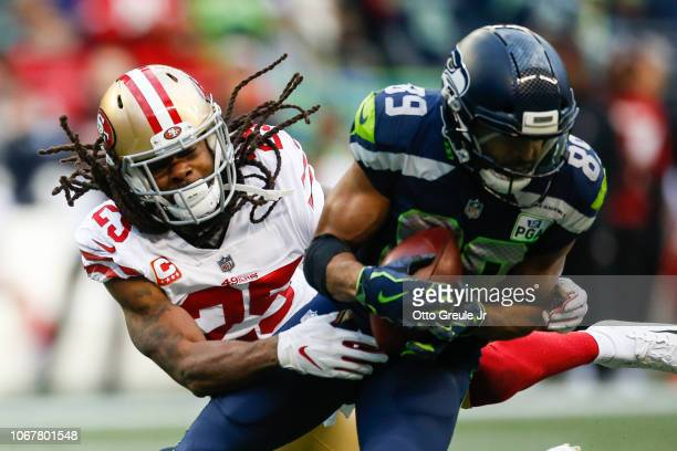 Richard Sherman of the San Francisco 49ers attempts to tackle former teammate Doug Baldwin of the Seattle Seahawks in the third quarter at...