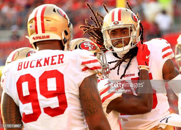 Richard Sherman of the San Francisco 49ers celebrates an interception returned for a touchdown during a game against the Tampa Bay Buccaneers at...