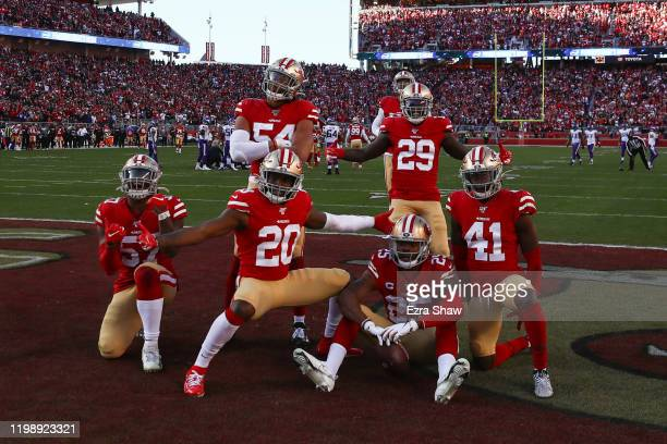 Richard Sherman of the San Francisco 49ers celebrates with teammates after intercepting a pass by Kirk Cousins of the Minnesota Vikings in the third...