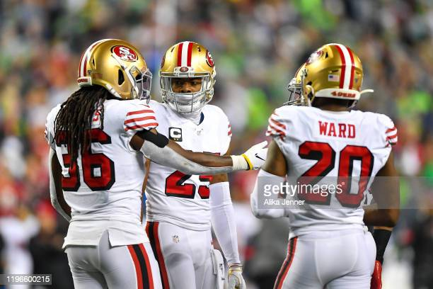 Richard Sherman of the San Francisco 49ers, center, and Marcell Harris, left, and Jimmie Ward talk things out during a timeout in the fourth quarter...