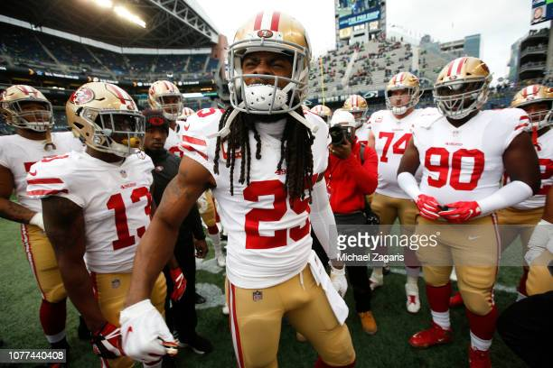 Richard Sherman of the San Francisco 49ers fires up the team on the field prior to the game against the Seattle Seahawks at CenturyLink Field on...
