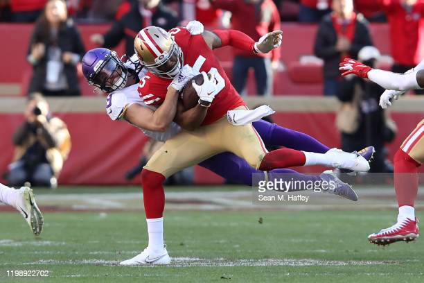 Richard Sherman of the San Francisco 49ers intercepts a pass by Kirk Cousins of the Minnesota Vikings in the third quarter of the NFC Divisional...