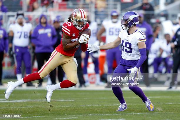 Richard Sherman of the San Francisco 49ers intercepts a pass intended for Adam Thielen of the Minnesota Vikings during the second half of the NFC...