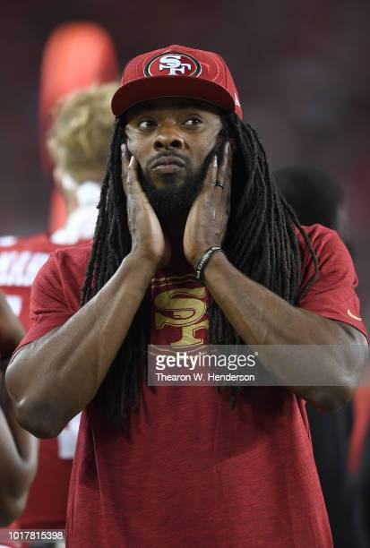 Richard Sherman of the San Francisco 49ers looks on from the sidelines against the Dallas Cowboys in the fourth quarter of their NFL preseason...
