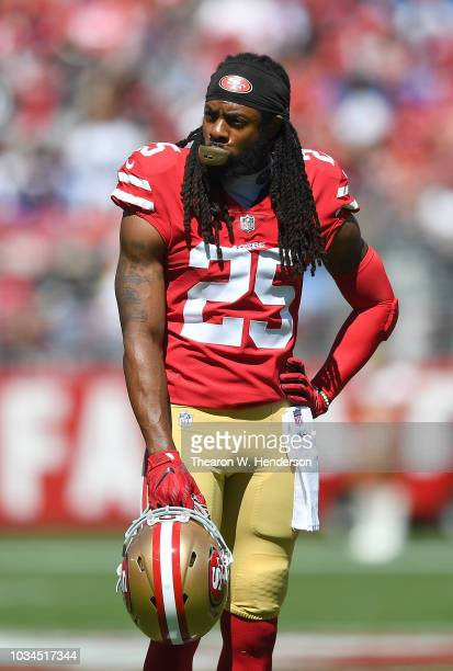 Richard Sherman of the San Francisco 49ers looks on while waiting on the officials to review a play that was confirmed as a touchdown for the Detroit...