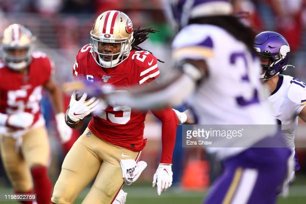 Richard Sherman of the San Francisco 49ers runs after intercepting a pass by Kirk Cousins of the Minnesota Vikings in the third quarter of the NFC...
