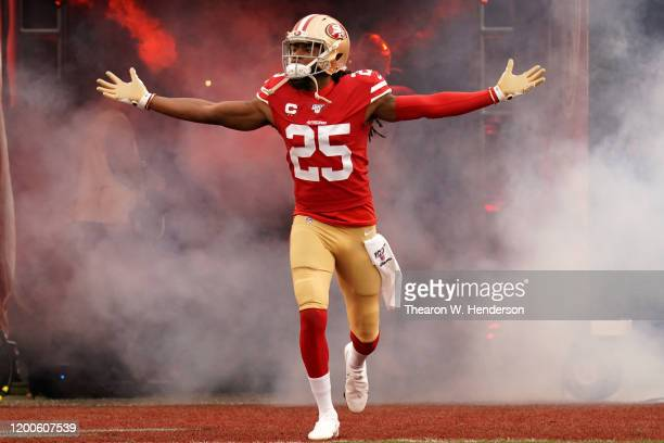 Richard Sherman of the San Francisco 49ers runs onto the field prior to the start of the NFC Championship game against the Green Bay Packers at...