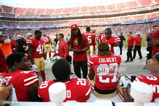 Richard Sherman of the San Francisco 49ers talks with the defensive backs on the sideline during the game against the Dallas Cowboys at Levi Stadium...