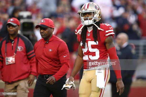 Richard Sherman of the San Francisco 49ers walks off the field after being ejected for fighting during their NFL game against the Chicago Bears at...