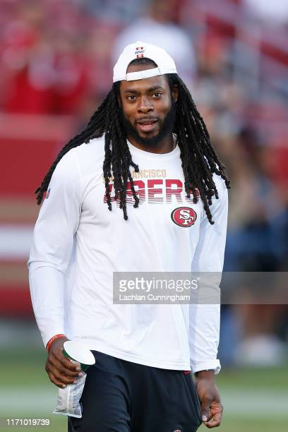 Richard Sherman of the San Francisco 49ers walks onto the field before the preseason game against the Los Angeles Chargers at Levi's Stadium on...
