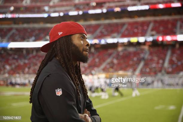 Richard Sherman of the San Francisco 49ers watches a replay on the big screen during their preseason game against the Los Angeles Chargers at Levi's...