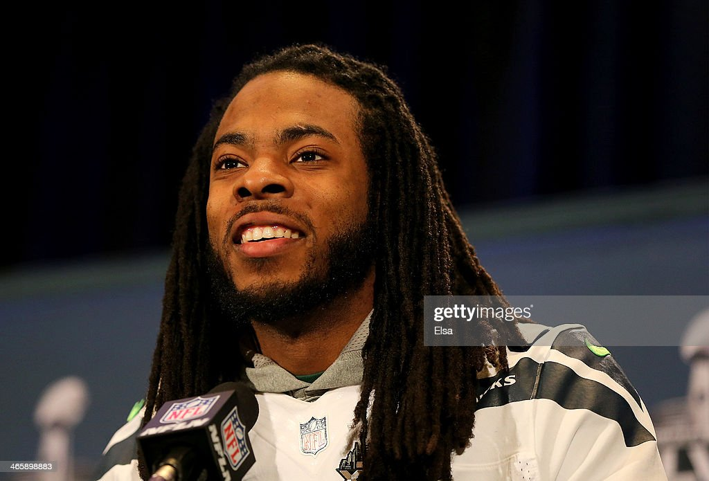 Richard Sherman #25 of the Seattle Seahawks addresses the media during Super Bowl XLVIII media availability at the Westin Hotel January 30, 2014 in Jersey City, New Jersey. The Denver Broncos and Seattle Seahawks will meet in Super Bowl XLVIII at Metlife Stadium on February 2, 2014.