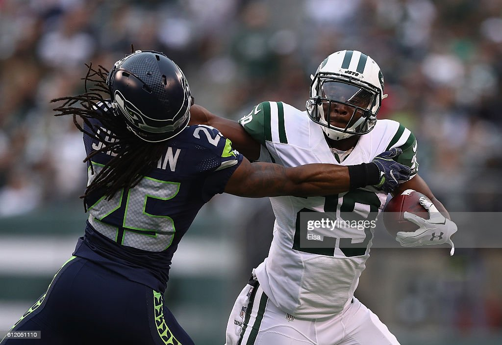 Richard Sherman #25 of the Seattle Seahawks attempts to tackle Bilal Powell #29 of the New York Jets in the first half at MetLife Stadium on October 2, 2016 in East Rutherford, New Jersey.