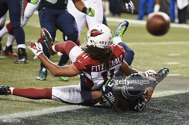 Richard Sherman of the Seattle Seahawks breaks up a pass intended for Larry Fitzgerald of the Arizona Cardinals during the first quarter of a game...