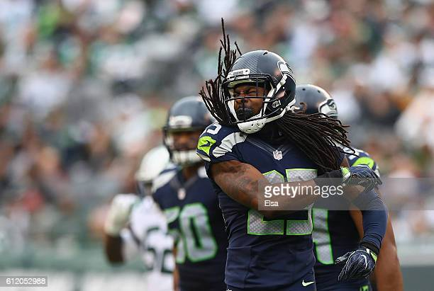 Richard Sherman of the Seattle Seahawks celebrates an interception in the third quarter against the New York Jets at MetLife Stadium on October 2,...