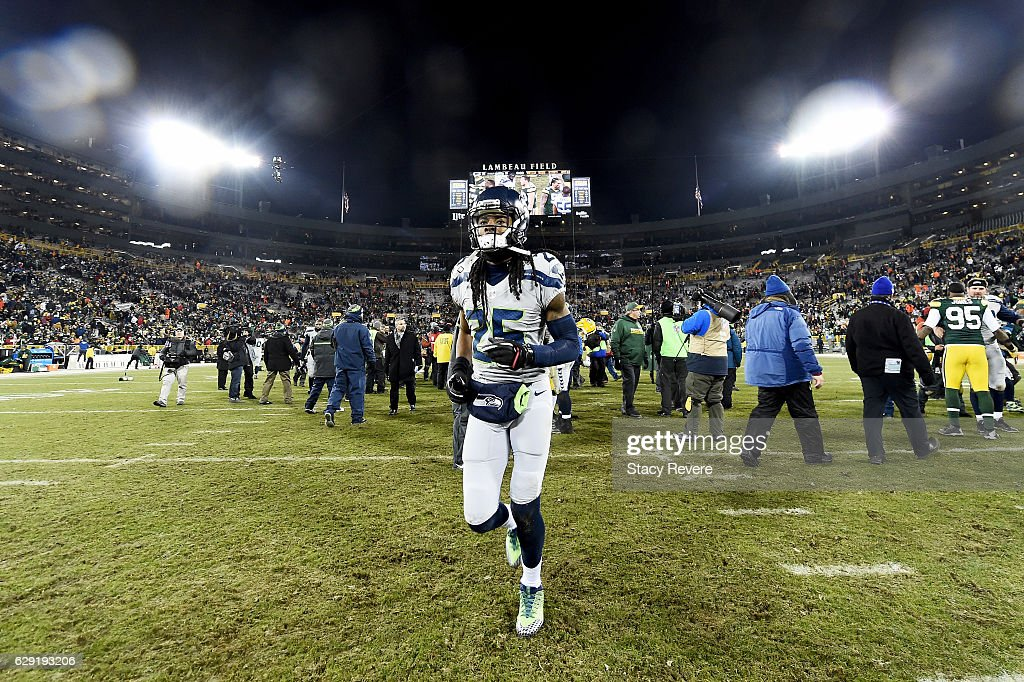 Richard Sherman #25 of the Seattle Seahawks jogs off the field after the Green Bay Packers beat the Seattle Seahawks 38-10 at Lambeau Field on December 11, 2016 in Green Bay, Wisconsin.