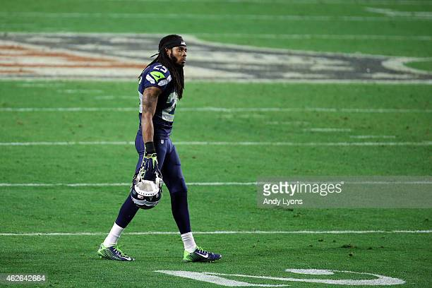 Richard Sherman of the Seattle Seahawks looks on late in the game against the New England Patriots during Super Bowl XLIX at University of Phoenix...