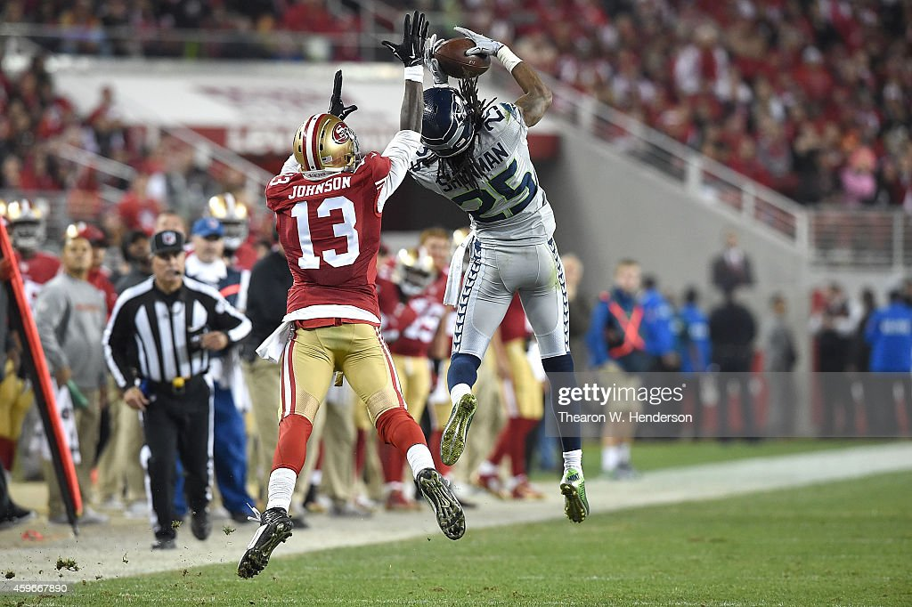 Richard Sherman #25 of the Seattle Seahawks makes an interception in the fourth quarter on a ball intended for Steve Johnson #13 of the San Francisco 49ers at Levi's Stadium on November 27, 2014 in Santa Clara, California.