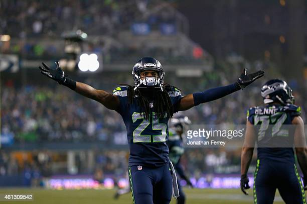 Richard Sherman of the Seattle Seahawks reacts after a play against the Carolina Panthers during the 2015 NFC Divisional Playoff game at CenturyLink...