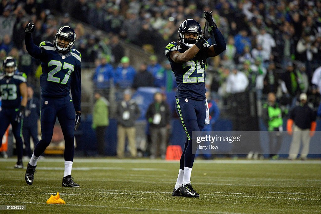 Richard Sherman #25 of the Seattle Seahawks reacts against the Carolina Panthers during the 2015 NFC Divisional Playoff game at CenturyLink Field on January 10, 2015 in Seattle, Washington.