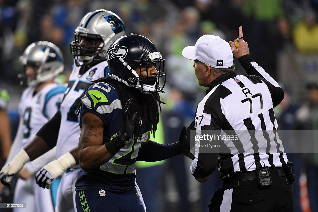 Richard Sherman #25 of the Seattle Seahawks reacts to call in the second quarter against the Carolina Panthers during the 2015 NFC Divisional Playoff game at CenturyLink Field on January 10, 2015 in Seattle, Washington.